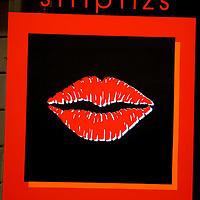 Europe, Latvia, Riga. A sign in  a Riga nightclub window advertising striptease.
