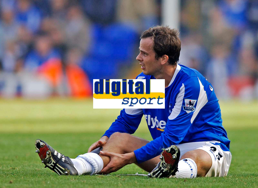 Photo: Glyn Thomas.<br />Birmingham City v Aston Villa. The Barclays Premiership.<br />16/10/2005.<br /> Birmingham's Stephen Clemence clutches his leg in pain after sustaining an injury. He was then substituted.