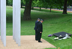 © under license to London News Pictures. London.  07/07/2011.  Chief Constable Andy Trotter of the British Transport And Chief Superintendent Mark Newton lay a wreath. People pay their respects to the victims of the 7/7 bombings in London today (Thurs) by the Hyde Park Memorial on the 6th anniversary of the tragedy.  See special instructions. Mandatory credit Neil Hall/London News Pictures.