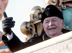 09 February 2010. New Orleans, Louisiana, USA. <br /> Tom Benson, owner of the Saints leads the team as Saints Mania captures New Orleans like no other parade. The New Orleans Saints victorous NFL football team makes its way from the Superdome through the city. Drew Brees and the crew make their way through screaming fans. The team salutes the massed crowds along the victory parade route in downtown New Orleans following the team's stunning victory over the Indianapolis Colts for Superbowl 44. <br /> Photo ©; Charlie Varley. Varleypix.com