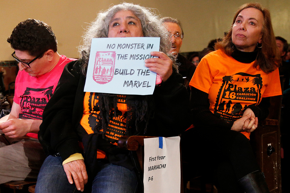 """Community members against a housing project often referred by critics as the """"Monster in the Mission,"""" on Thursday, Feb. 7, 2019, in San Francisco, Calif. A community meeting was held at Mission High School to hear public reaction on the housing project for 1979 Mission Street."""