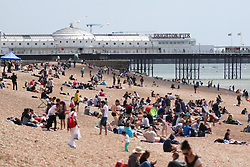 © Licensed to London News Pictures. 07/06/2015. Brighton, UK. People are sunbathing on the beach in Brighton as temperatures are expected to be some of the hottest of the year so far. today June 7th 2015. Photo credit : Hugo Michiels/LNP