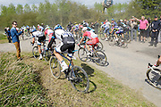 France, April 13th 2014: Riders including Niklas Arndt (#122), Team Giant-Shimano, and Team Katusha's Vladimir Gusev (#62), use both  sides of the road to avoid a crash at Pont Gibus, Wallers, during the 2014 Paris Roubaix cycle race.