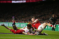Gareth Anscombe of Wales (l) scores a try in the 1st half as Anthony Watson of England © gets in between Anscombe and Steff Evans of Wales ® and the 'try' is disallowed after referee Jerome Garces goes to the TMO.  England v Wales, NatWest 6 nations 2018 championship match at Twickenham Stadium in Middlesex, England on Saturday 10th February 2018.<br /> pic by Andrew Orchard, Andrew Orchard sports photography