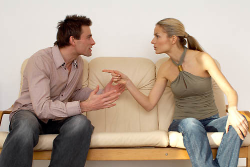 couple on a sofa, domestic moment, making up, affairs of the heart, serious conversation, relationship problems, marital problems, communication breakdown, sexual problems<br />