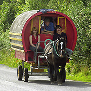 A horse drawn caravan makes its way around the country roads in County Kerry Ireland.<br /> Picture by Don MacMonagle -macmonagle.com