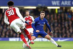 10 January 2018 - Football League Cup - Chelsea v Arsenal - Eden Hazard of Chelsea stretches as he marks Ainsley Maitland-Niles of Arsenal - Photo: Charlotte Wilson / Offside