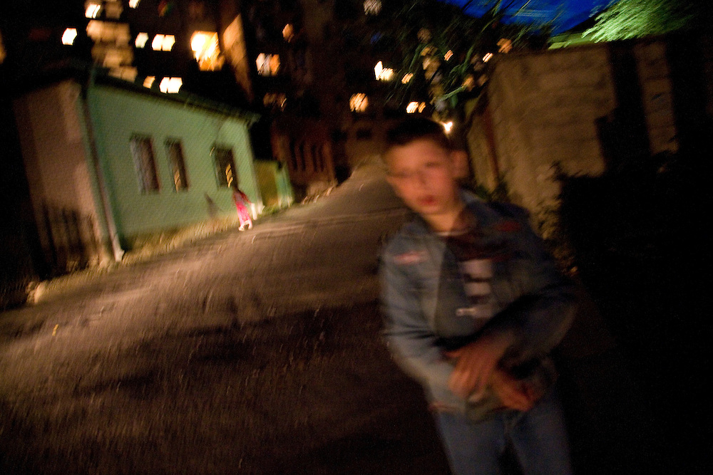Children play in the streets after dark in the Serb section...Scenes from Kosovska Mitrovica, Kosovo, Serbia.