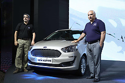 October 4, 2018 - Delhi, India - Anurag Mehrotra, President and Managing Director, Ford India..Vinay Raina, executive director, Marketing, Sales and Service, Ford India during The New Ford Aspire. (Credit Image: © Jyoti Kapoor/Pacific Press via ZUMA Wire)