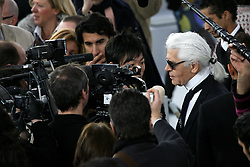 Karl Lagerfeld walks with a model at the end of his Haute-Couture Spring-Summer 2008 fashion show for Chanel held at the Grand Palais, in Paris, France, on January 22, 2008. Photo by Nebinger-Taamallah/ABACAPRESS.COM