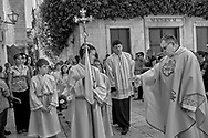 Religious procession with priests and boys in surpluses in Trogir Croatia