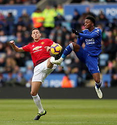 Manchester United's Nemanja Matic battles for the ball with Leicester City's Demarai Gray