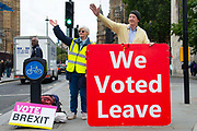 Pro leave protesters wave to supporters outside the Houses of Parliament on 9th September 2019 in London, United Kingdom. Prime Minister Boris Johnson is tabling another motion to seek a general election.