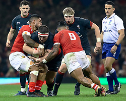 Wyn Jones of Wales under pressure from Sonatane Takulua of Tonga<br /> <br /> Photographer Simon King/Replay Images<br /> <br /> Under Armour Series - Wales v Tonga - Saturday 17th November 2018 - Principality Stadium - Cardiff<br /> <br /> World Copyright © Replay Images . All rights reserved. info@replayimages.co.uk - http://replayimages.co.uk