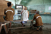 """Minimum security inmates relaxing at the """" game """" center of the prison, jan 2012."""
