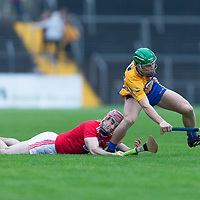 Clare's Gary Cooney in action against Cork's David Lowney