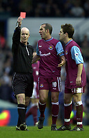 Photo: Greig Cowie<br />Barclaycard Premiership. Leeds United v West Ham United. 08/02/2002<br />Joe Cole and Paolo di Canio protest to Dermot Gallagher as he sends off Freddie Kanoute