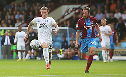 Jason Cummings of Peterborough United in action with Rory McArdle of Scunthorpe United - Mandatory by-line: Joe Dent/JMP - 13/10/2018 - FOOTBALL - Glanford Park - Scunthorpe, England - Scunthorpe United v Peterborough United - Sky Bet League One
