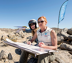 October 17, 2018 - Johnson Valley, California, U.S. - WENDY FISHER, right, and BROOKE JACKSON plot their course on Day 5 of the third annual Rebelle Rally, the first women's off-road navigation rally in the United States. The event features a unique scoring system in which precise navigation - not speed - is the ultimate goal.  With cell phones and GPS devices banned during the 10-day event, and armed with just maps, compasses and roadbooks, 43 two-person teams are tasked with scoring points based on time, distance and hidden checkpoints as they make their way across 1,600 miles of scrub brush, sand dunes and boulders in the Nevada and California desert.(Credit Image: © Brian Cahn/ZUMA Wire)