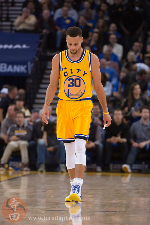 November 17, 2015; Oakland, CA, USA; Golden State Warriors guard Stephen Curry (30) during the third quarter against the Toronto Raptors at Oracle Arena. The Warriors defeated the Raptors 115-110.