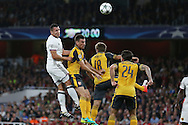 Marek Suchy of FC Basel leaps over Laurent Koscielny of Arsenal  (2nd left) to head the ball. UEFA Champions league group A match, Arsenal v FC Basel at the Emirates Stadium in London on Wednesday 28th September 2016.<br /> pic by John Patrick Fletcher, Andrew Orchard sports photography.