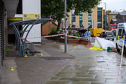 © Licensed to London News Pictures. 21/08/2021. London, UK. Evidence identification markers and a forensic tent  at the scene of a fatal stabbing in Kingston. Police were called to a disturbance on Clarence Street at 03:45BST where they found a 22-year-old male with a stab injury to the chest, he was taken to hospital by London Ambulance Service where he was pronounced dead. An 18-year-old male was arrested at the scene on suspicion of murder.Photo credit: Peter Manning/LNP
