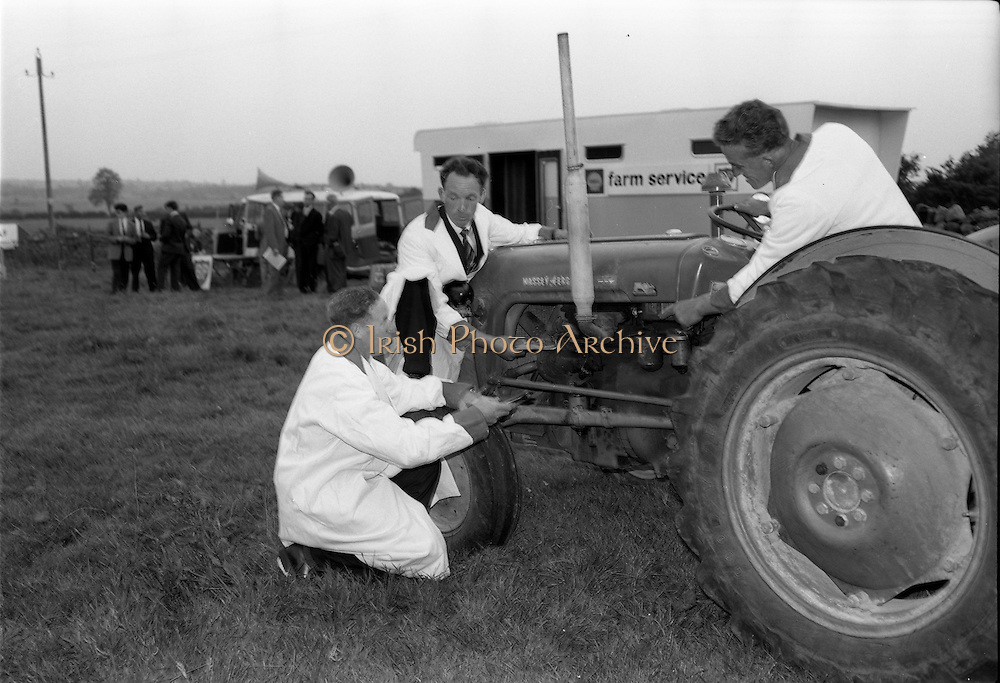 2/07/1963<br /> 07/02/1963<br /> 02 July 1963<br /> Macra na Feirme/Irish Shell and BP Ltd. Farm Tasks Competitions Connacht Finals at Strokestown, Co. Roscommon. The competition was won by a team from Strokestown Branch representing Roscommon. Photo shows the Strokestown team competing in the tractor maintenance section are (l-r): Vincent Cox; Sean Brennan and Peter Dolan.