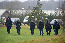 © Licensed to London News Pictures 10/03/2021. Ashford, UK. Members of a Met Police team searching in the grounds. Teams of police officers are at Great Chart Leisure in Ashford, Kent which is believed to be part of an ongoing investigation into the disappearance of Sarah Everard from London. Photo credit:Grant Falvey/LNP
