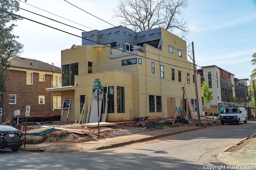 Construction of  new mulit story apartments, new business buildings and single family homes dot the Historic Fourth Ward