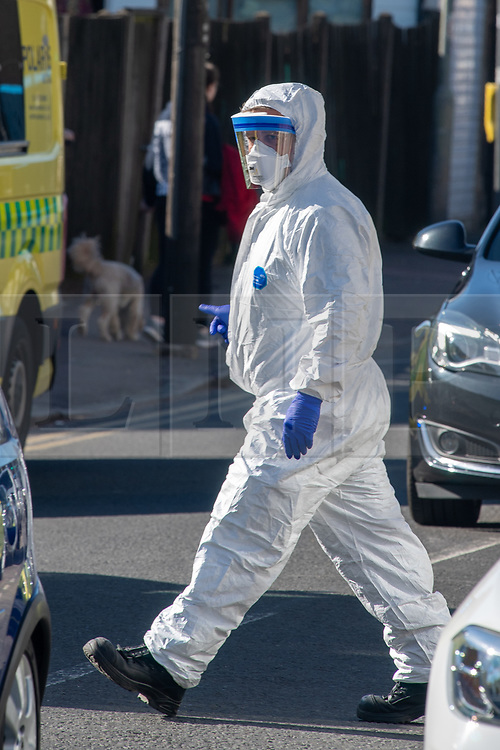 © Licensed to London News Pictures. 04/04/2020. Watford, UK. A paramedic wearing personal protective equipment outside an address in Watford. Paramedics responded to a medical incident in Watford, an ambulance and two incident response units attended   Photo credit: Peter Manning/LNP
