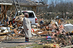 24 February 2016. Schexnaydre St, Convent, Louisiana.<br /> Scenes of devastation following a deadly EF3 tornado touchdown. 2 confirmed dead. A resident stares in disbelief at the damage all around her.<br /> Photo©; Charlie Varley/varleypix.com