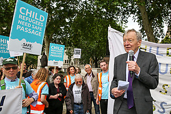 © Licensed to London News Pictures. 18/06/2019. London, UK. Lord Dubs (R) speaking at the Safe Passage  demonstration in Parliament Square, as the campaigners are calling on the Government to welcome 10,000 child refugees. Lord Dubs arrived in the UK on the Kindertransport as a child refugee, along with nearly 10,000 predominantly Jewish children who were fleeing Nazi controlled Europe. Photo credit: Dinendra Haria/LNP