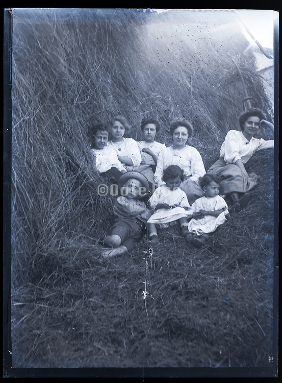 happy family sitting in a haystack France ca 1920s