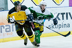 Blaz Javornik of HK Slavija vs Rok Klavzar of HK Olimpija during of ice-hockey match between HK Olimpija and HK Slavija in  SLOHOKEJ league, on September 21, 2011 at Hala Tivoli, Ljubljana, Slovenia. (Photo By Matic Klansek Velej / Sportida)