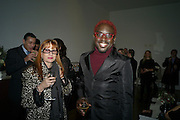 AINE MARSLAND; AIZAK BUYANDO, THE LAUNCH OF THE KRUG HAPPINESS EXHIBITION AT THE ROYAL ACADEMY, London. 12 December 2011.