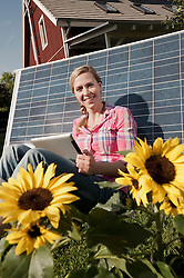 Solar panel woman leaning tablet computer