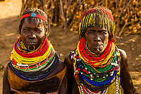 Nyangatom tribe woman wearing layers of beaded necklaces as decoration. Omo Valley, Ethiopia.