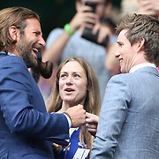 LONDON, ENGLAND - JULY 16: Eddie Redmayne and his wife Hannah Bagshawe talk with Bradley Cooperat the Mens Singles Final between Roger Federer of Switzerland and Marin Cilic of Croatia during the Wimbledon Lawn Tennis Championships at the All England Lawn Tennis and Croquet Club at Wimbledon on July 16, 2017 in London, England. (Photo by Tim Clayton/Corbis via Getty Images)