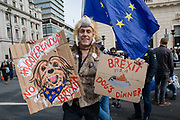 A man dressed as a dog holding anti Brexit placards joins pet owners to take part in an anti Brexit Wooferendum rally on October 07, 2018 in London, England to protest against Britain leaving the European Union.