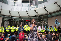 London, UK. 11 October, 2019. A woman addresses climate activists from Extinction Rebellion blocking the main entrance to the BBC's New Broadcasting House on the fifth day of International Rebellion protests. They were demanding that the broadcaster 'tell the truth' regarding the climate emergency.