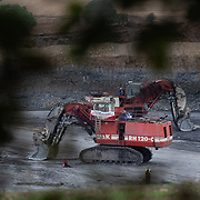 Nee More Coal action in the Pont Valley. Two climate activists locked on to digger in Field House surface mine. The mine is owned by Hargreaves and the mine was shut for the day. No were arrested.The action was part of a peaceful mass demonstration by local actvists and climate protectors.