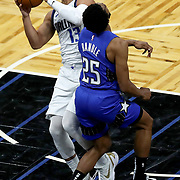 ORLANDO, FL - MARCH 01: Chasson Randle #25 of the Orlando Magic fouls Jalen Brunson #13 of the Dallas Mavericks during the second half at Amway Center on March 1, 2021 in Orlando, Florida. NOTE TO USER: User expressly acknowledges and agrees that, by downloading and or using this photograph, User is consenting to the terms and conditions of the Getty Images License Agreement. (Photo by Alex Menendez/Getty Images)*** Local Caption ***Chasson Randle; Jalen Brunson