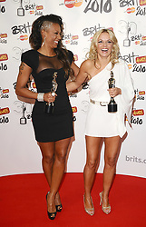Geri Halliwell (right) and Melanie Brown (left) collect the award for 'Best Brit perforamce of 30 years' on behalf of the Spice Girls during the BRIT Awards 2010, at Earls Court, London.