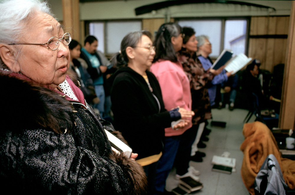 After the service in Iñupiaq, a singspiration goes on every Sunday night at the Presbiterian Church. <br /> <br /> Martha Aiken on the very left.<br /> <br /> Up on the wall there is a piece of baleen, a common decoraction artifact in Barrow.<br /> <br /> May 18, 22:05