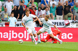 Ales Mertelj of Slovenia and Valter Birsa of Slovenia during the EURO 2016 Qualifier Group E match between Slovenia and England at SRC Stozice on June 14, 2015 in Ljubljana, Slovenia. Photo by Mario Horvat / Sportida