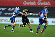 Josh Matavesi of the Ospreys (c) looks to go past Oliver Griffiths (l) of the Newport Gwent Dragons .Guinness Pro12 rugby match, Ospreys v Newport Gwent Dragons at the Liberty Stadium in Swansea, South Wales on 29th October 2016.<br /> pic by Andrew Orchard, Andrew Orchard sports photography.