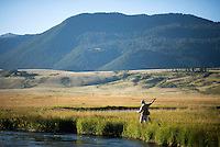 Jack Holland fishes a bend in Flat Creek while angling with his son on opening day of fishing Saturday on the National Elk Refuge.