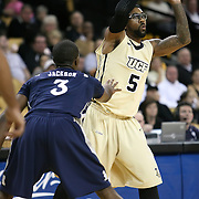 Tamir Jackson (3) defends Central Florida guard Marcus Jordan (5) during a Conference USA NCAA basketball game between the Rice Owls and the Central Florida Knights at the UCF Arena on January 22, 2011 in Orlando, Florida. Rice won the game 57-50 and extended the Knights losing streak to 4 games.  (AP Photo/Alex Menendez)