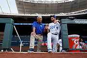 Former Kansas City Royals player George Brett, left, visits with catcher Drew Butera, right before a baseball game against the St. Louis Cardinals at Kauffman Stadium in Kansas City, Mo., Saturday, Aug. 11, 2018. (Photo/Colin E. Braley)