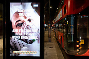 A government NHS (National Heath Service) ad at a bus stop displays the face of a Covid patient, urging Londoners to stay at home and to socially distance, outside the Royal Courts of Justice, on 2nd February 2021, in London, England.